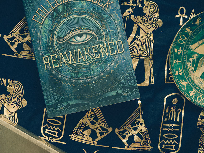 Reawakened by Colleen Houck against an Egyptian fabric