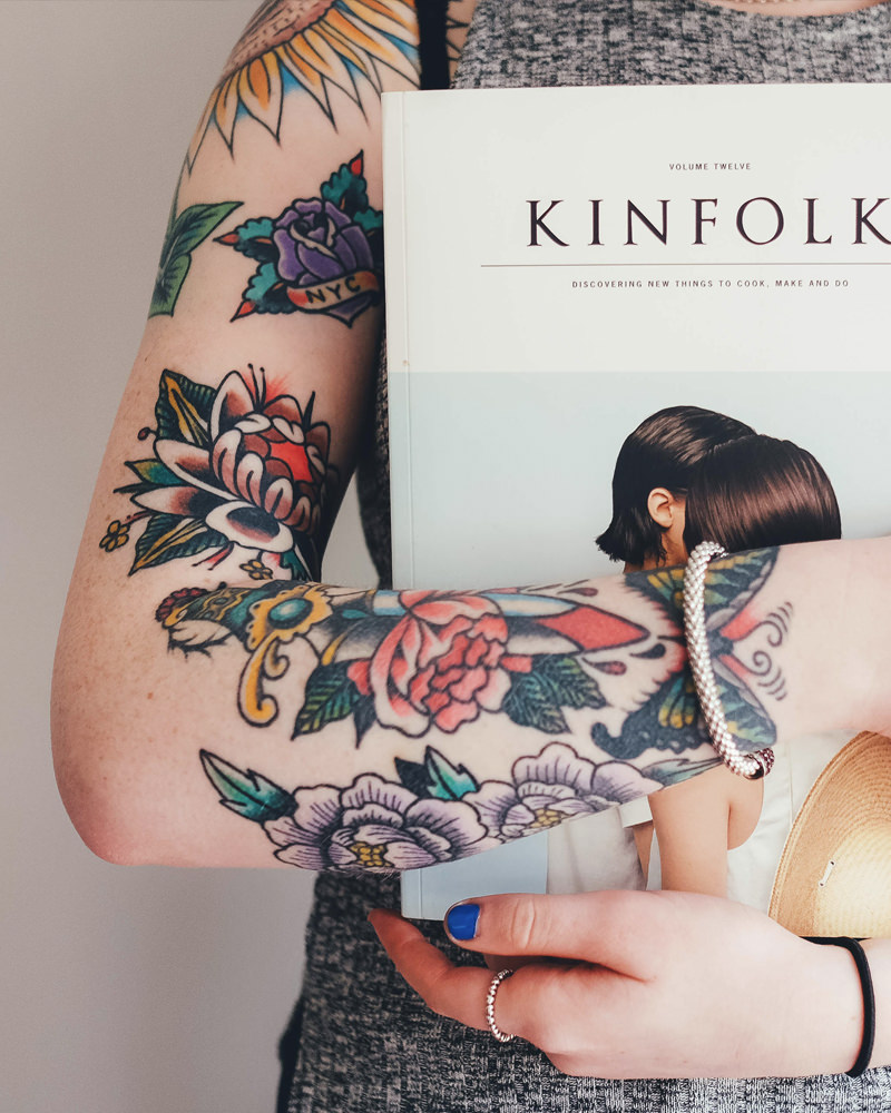 Tattooed girl holding a book